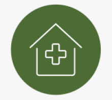 Green circle with outline of home and care insignia in white inside
