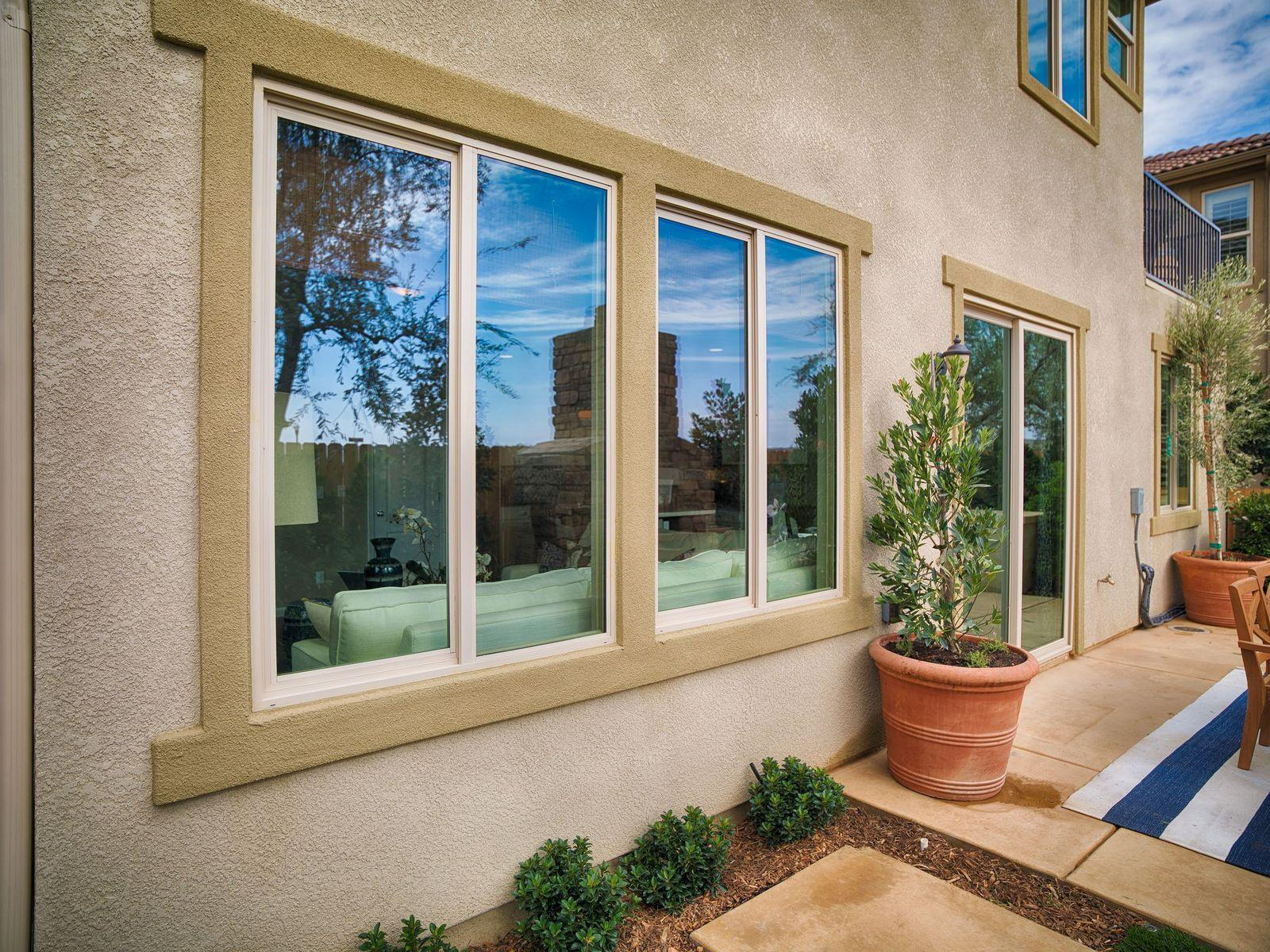 monte verde bay view windows from outside stucco home