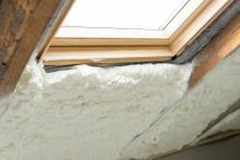 spray foam insulation in attic with window