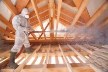 contractor blowing insulation
