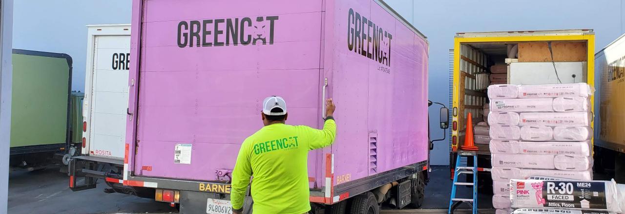 Greencat Employee Unloading Truck-Full of R-30 Insulation