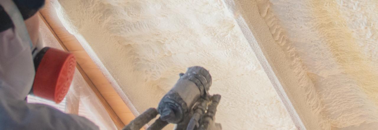 Spray foam insulation being sprayed in attic