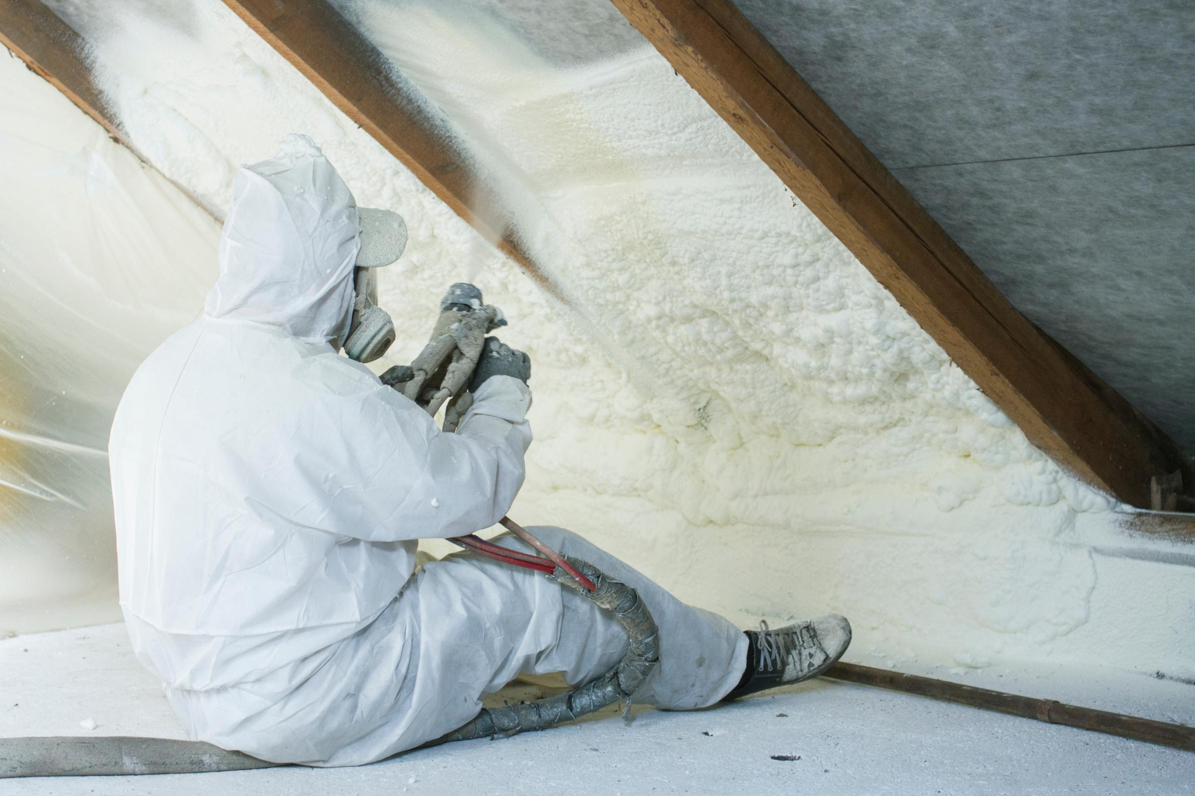 Spray Foam Insulation Being Applied To Attic