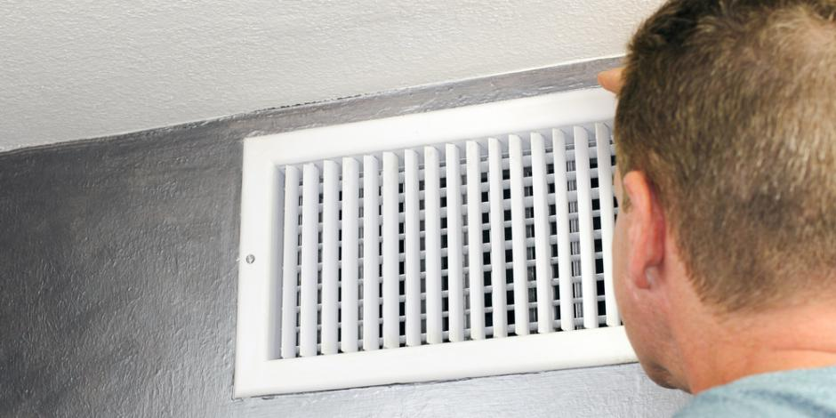 GreenCat tech inspecting air duct
