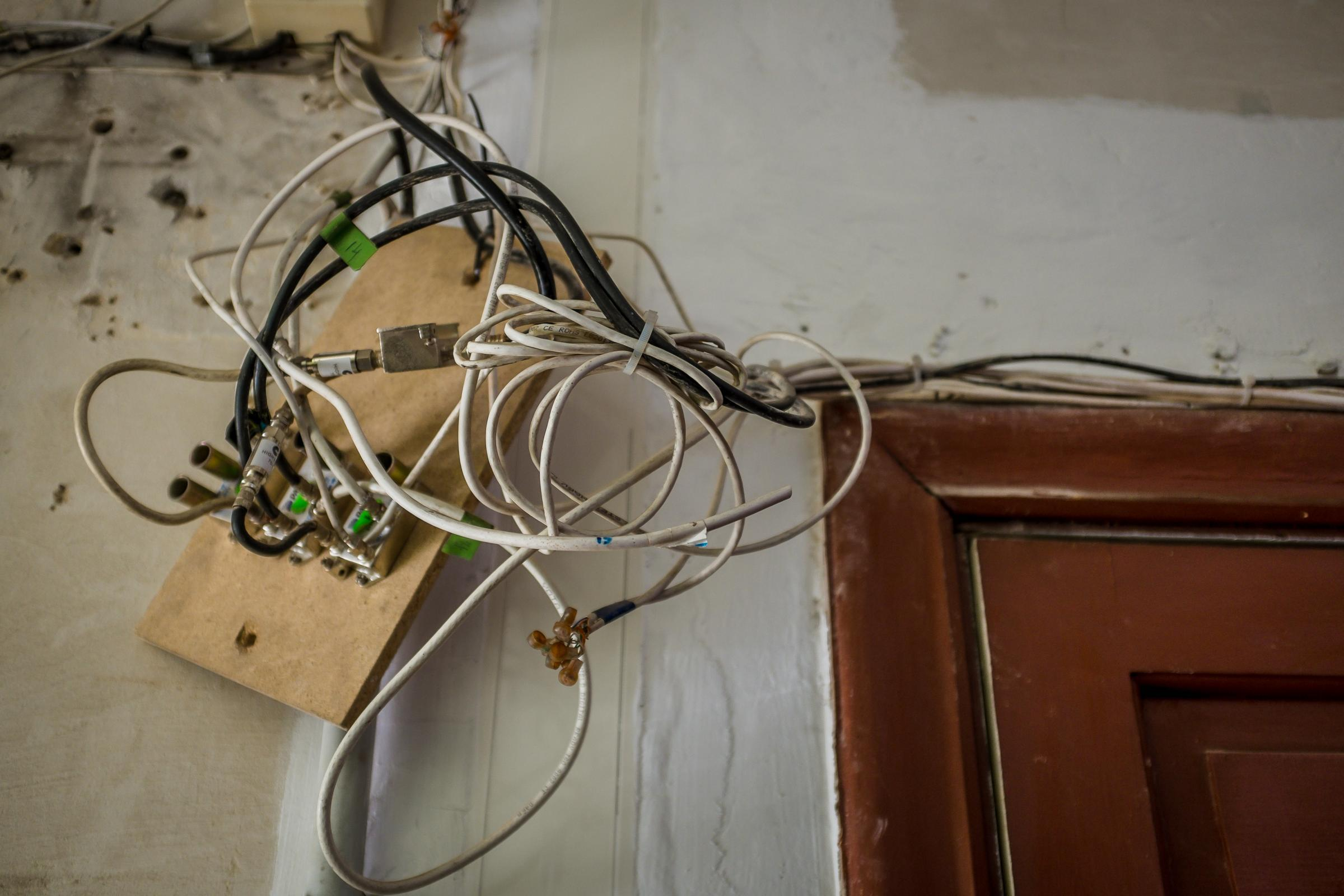 electrical wires hanging from ceiling in old house