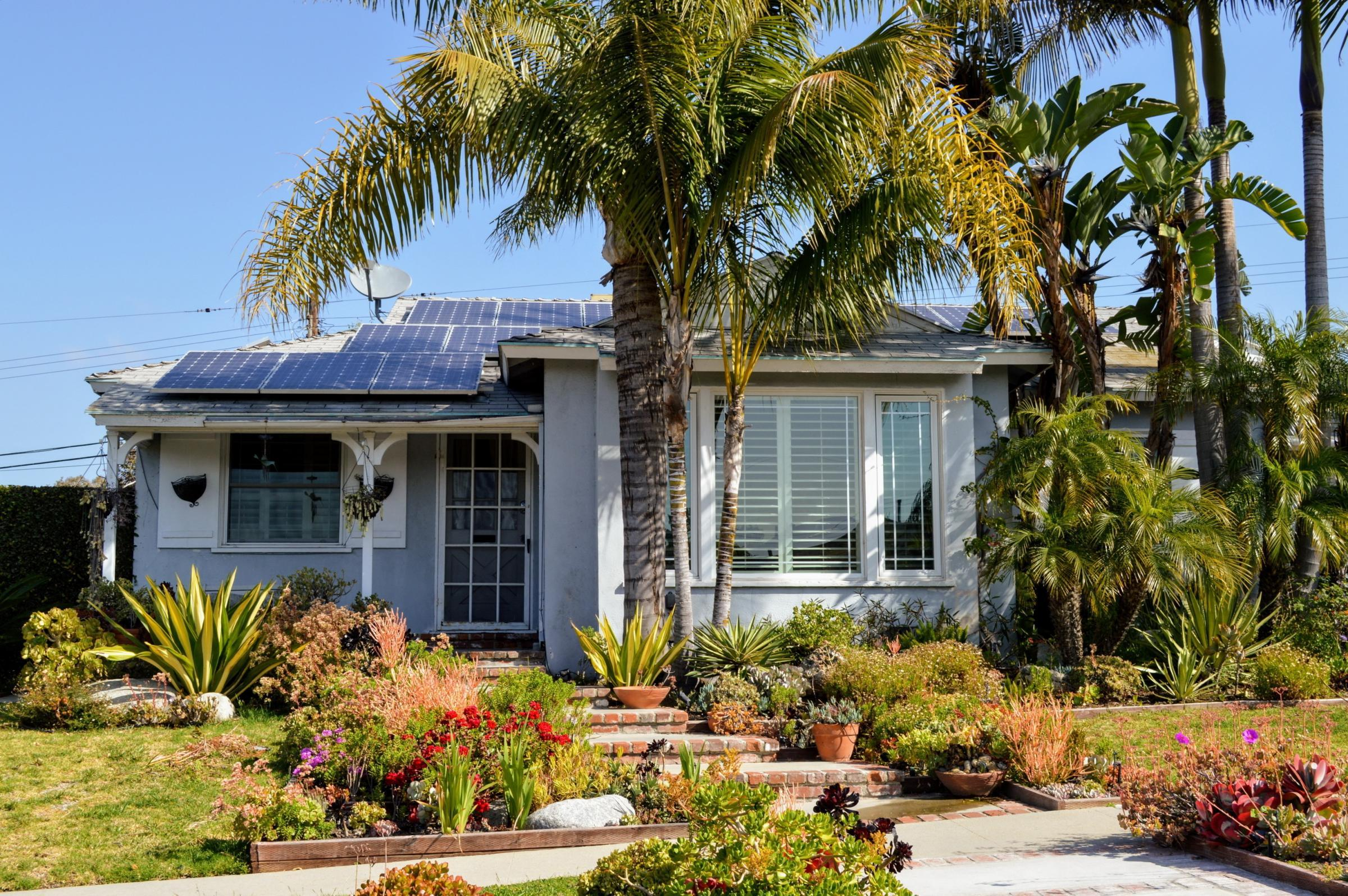 modern California home with solar panels on roof