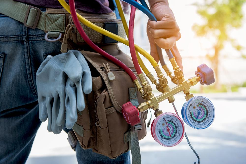 Hand holding HVAC maintenance equipment
