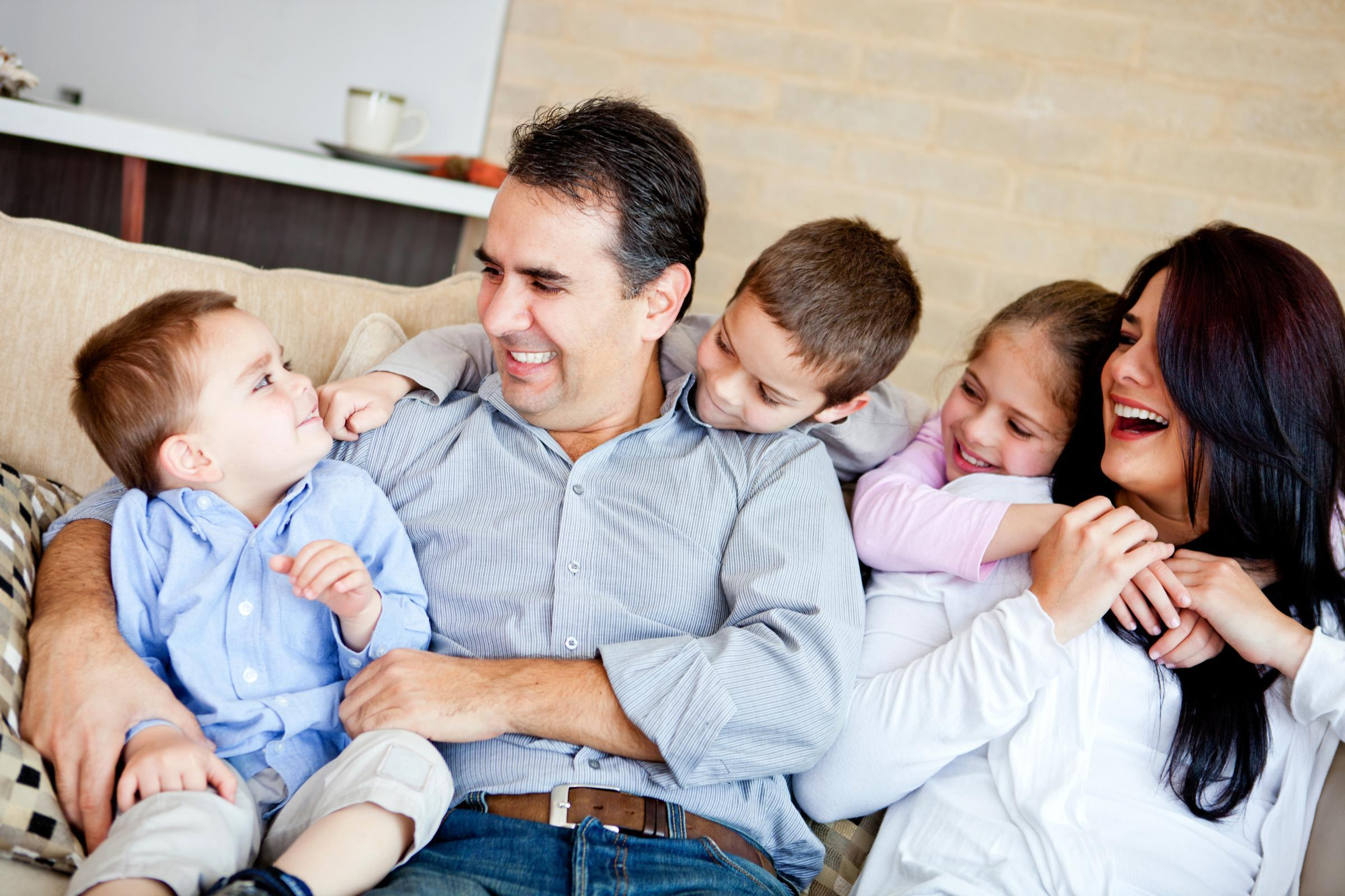 Happy Family in Living Room Couch